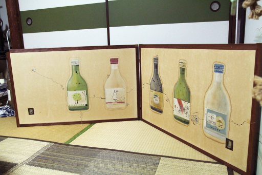 Aoki-san's folding screen with Saké bottles